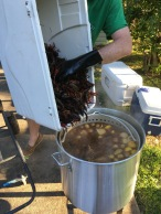 Into the pot they go. The first batch of 60 pounds of crawfish