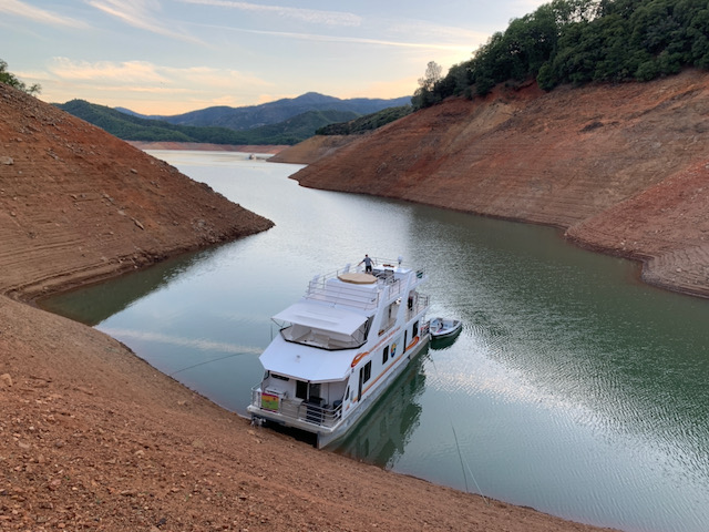 houseboat with high dirt walls around it